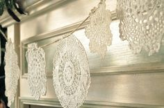 Garland of doilies, stiffened with glue, sparkly with glitter - reminds me of snowflakes.