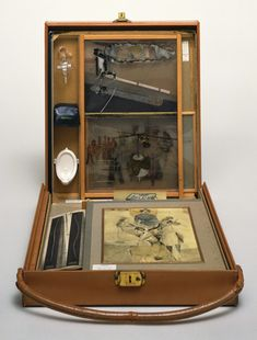 "MoMA | The Collection | Marcel Duchamp. Box in a Valise (From or by Marcel Duchamp or Rrose Sélavy). 1935-41Leather valise containing miniature replicas, photographs, color reproductions of works by Duchamp, and one ""original"" drawing"