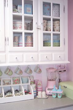 I like the hooks for cups idea!  I will do this under my cupboards.
