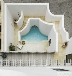 A view from above of the outdoor shower and pool; the encaustic floor tiles are by Hacienda Studios. - ELLEDecor.com
