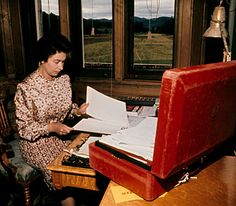 September 1972 - The Queen works on official papers at her desk at Balmoral Castle