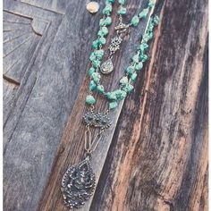 """NWT-LOVE HEALS necklace $379 Gorgeous wire wrapped 36"""" necklace by LOVE HEALS.Wire wrapped turquoise gems finished with hand carved white bronze charms and toggle closure. Really spectacular statement piece! Ganesh is one of the most worshipped Hindu deities revered as the remover of obstacles.Top pendant has an OM on one side and Ganesh on the other Love Heals Jewelry Necklaces"""