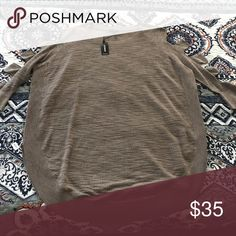 NWT Express Thermal Tee Cold shoulder detail and curved hem. Perfectly flowy but not oversized! Never worn and looking for a new closet!! It's a light brown/heathered brown color. Express Tops Tees - Long Sleeve