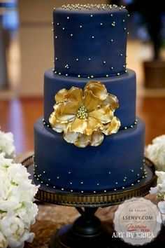 A dark cake with a metallic pop is always fun. #wedding #reception #weddingcakes #popofcolor #gold #navy #inspiration #ideas