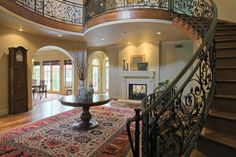 entryway with detailed designed stairway and fireplace