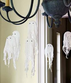 Cheesecloth ghosts: tape the bottom of a plastic cup to the bottom of another plastic cup and place it on a table.  Blow up a balloon and place it in the top cup.  Cut cheesecloth into pieces about 8 inches square.  Dip into fabric stiffener and drape over balloon.  Allow to dry 10 minutes then pop balloon to reveal hardened shape.  Add eyes then hang with fishing wire.
