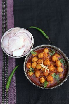 Punjabi Chole Masala Recipe - Popular North Indian Curry made with White Chickpeas and Indian Spices.