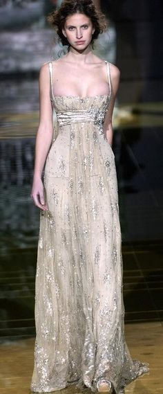 Elie Saab.  I do really like this dress, but pinned this mostly cause I don't believe I've ever seen a model w/breasts.