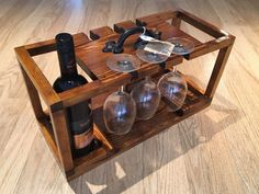 Handcrafted cutting wine caddy for lovers of the grape. handmade in Glasgow, Scotland. .name personalisation available on request. .Holds 4 bottles of wine and 6 wine glasses. For International shipping please contact me for details...