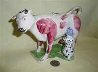 English pottery cow creamers were wildly popular, if dangerous, starting in late Cow Creamer, English Pottery, Cute Cows, Good Company, Country Kitchen, Vintage Kitchen, Farm Animals, Pepper, Dinosaur Stuffed Animal