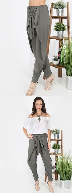 Get sophisticated with the Bow Tie Harem Pants! Features a center tie waist and an overall loose fit. Pair with a crop top and strappy stilettos for a glamorous ensemble!