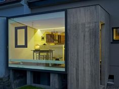 Window in a glass wall  Extension C House Addition by Loïc Picquet Architecte