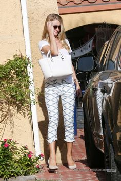 Rosie Huntington-Whiteley.. Etoile Isabel Marant - Almon Tee and Nea Boyfriend Jeans, with a Victoria Beckham Quincy tote..