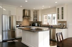 Small Kitchen Ideas Pictures Displaying Rectangle Black White Kitchen Island And L Shaped Kitchen Cabinet Including Stainless Steel Refrigerator As Well As Having Three Panel Glass Windows Casement, Trendy Ideas Of Charming White Cabinets Kitchen Design For Your Home Kitchens Inspiration: Interior, Kitchen