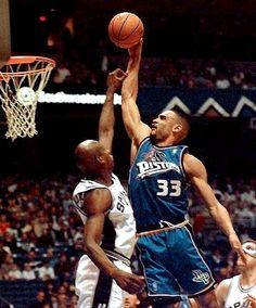 Grant Hill sports basketball nba all-star detroit pistons facial retired nba star duke university dunking on defender