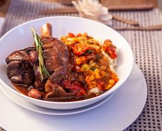 These tender lamb shanks in a rich tomato and olive sauce make an excellent meal for a celebration and are delicious with creamy, cheesy samp and spicy chakalaka. Creamy Samp Recipe, Roasted Lamb Shanks, Lamb Shank Recipe, Slow Roast, Baked Beans, Recipe Collection, Cooking Recipes, Yummy Recipes, Spicy