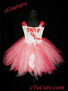 """This pinstripe creation isn't meant for a stuffy boardroom! Our specialty tutu is created with premium coral and white """"pinstripe"""" tulle and solid coral tulle t"""