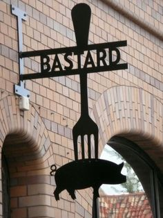 Bastard, restaurant in Malmo. I like the idea of this. Taime Salon with Shears instead of a pig and fork.