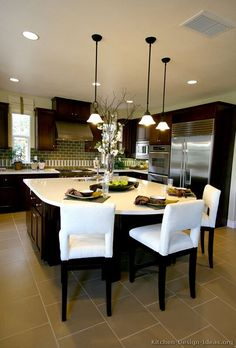 I don't love this kitchen, it's just here to remind me to consider white/light counters with dark wood cabinets. I like the overall effect.