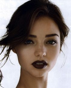 Theres just something riveting about dark lips and pale skin. I guess I like the drama. :)