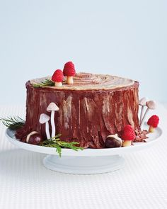 "Sugarplums aren't the only visions dancing around here. Serve dessert with a side of glamour at your holiday party or Christmas dinner -- or spoil Santa with a fat slice of cake on the mantel. We've reimagined the Yule log (or Buche de Noel) as a charming chestnut layer cake -- a ""Stump de Noel,"" if you will."