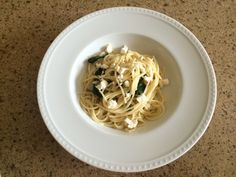 Spaghetti with spinach, onions, and feta cheese