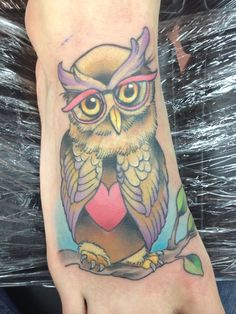 Owl with rose colored glasses tattoo