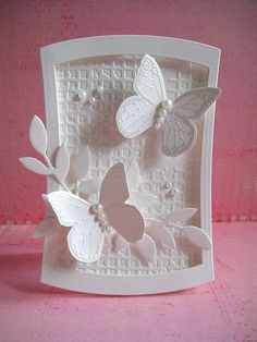 """White on white wedding card made with only one stamp--Traditional Butterfly.  Spellbinders Reverse Wonky Rectangles Stampin Up Sizzlits leaf die Tim Holtz Texture Fades """"Gridlock"""" folder Dimensional adhesive Pearls  Blogged here."""