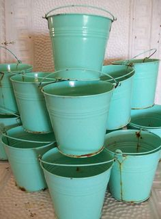 Rusty Buckets - I would LOVE to attach these to a OLD wooden fence, poke holes in the bottom and plant beautiful flowers, herbs and succulents in them!!