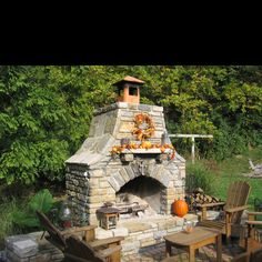 Great idea for fall and the wreath is so cute. Nice way to decorate our outside fireplace and make it a focal point.