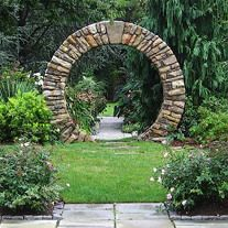Moongate by Garden Gate Landscaping Each piece was carefully split and chiseled to fit the tight radius of the 8' tall moongate.