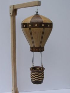 Wood turned hot air balloon - could be a neat desktop pencil holder or a bird feeder.