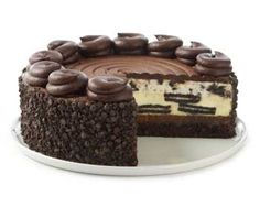 1 pkg. Oreo cookies  1/3 cup melted unsalted butter  3 pkgs. cream cheese (8 oz.)*  3/4 cup granulated sugar  4 eggs  1 cup sou...