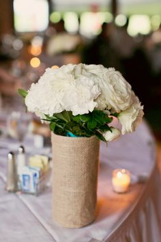 Burlap cylinders for the bridal bouquet on the head table.
