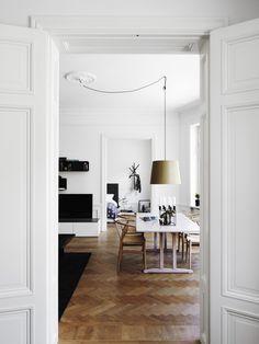 Crossed light wood floors.