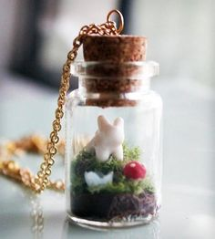 Adorable Bunny Terrarium Necklace By Iluxo. Wearable mini-garden with a bunny, mushroom and blue flower in a glass jar.