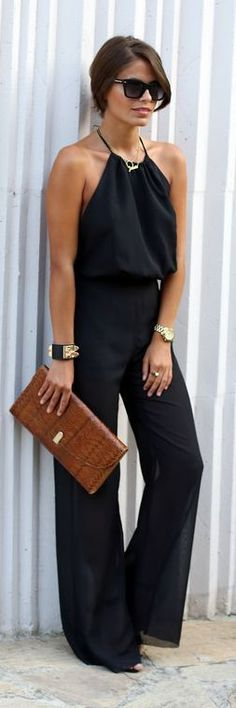 Street fashion elegant black jumpsuit with brown purse