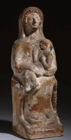 Demeter enthroned holding Kore in her lap - circa 600-500 BCE, from ancient Thebes - at the Louvre Museum