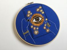 Book of Fate  Your fate is in your hands... This 8-inch embroidery hoop features delicate white, black and shades of marigold thread on cornflower blue fabric. Thousands of stitches and metallic gold thread brings this hoop to life.  All Thread Honey hoop art is handmade by me with lots of love and care. If you would like this embroidery (or any other) in a different color, size, fabric etc., just let me know (no extra charge)! Custom orders are always welcome.  This hoop is READY TO SHIP…