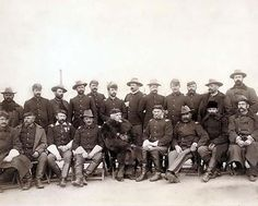 The fighting 7th officers.  The fighting 7th officers. It was made in 1891 by Grabill, John C. H., photographer. The illustration documents Twenty two uniformed military men, standing and sitting in camp chairs. Some of the men are wearing winter coats.