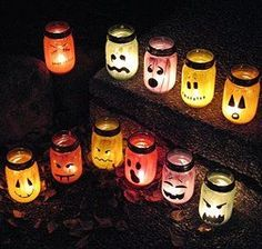 Haunting Halloween Luminaries are fun Halloween decorations made from painted jars that illuminate the darkness with eerie candlelight. Make these fun Halloween crafts for kids from mason jars and paint for a fun project and a great idea for outdoor Halloween decorations.