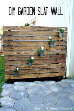 Back in the spring I revealed our DIY Stone Patio and today I'm sharing another big project that we just completed, a DIY Garden Slat Wall. I love it! And it was actually really easy.