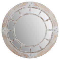 Bring eye-catching appeal to your entryway or master suite with this round wall mirror, showcasing a window-inspired design and whitewashed frame.