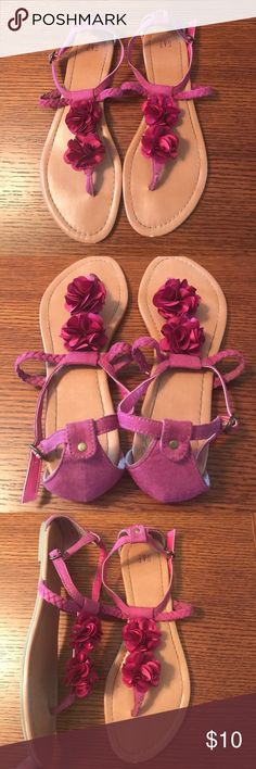 Women's Gap size 9 pink floral sandals Women's size 9 sandals from Gap. They are a hot pink color with flowers on the tops. There's an adjustable strap and buckle on the sides. There is a small area on the front of the left sandal that got bumped as shown in the last picture. Otherwise in good condition! GAP Shoes Sandals