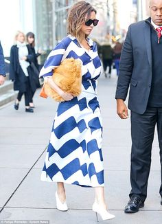 Is that a pet or a bag? Mrs Beckham is carrying – or perhaps cuddling – her latest designe...