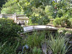 garden, wall, bridge, and pond