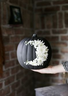 Get fancy with this craft pumpkin creation that channels the beauty of florals and turns a spooky decoration into a piece you'll want to display all year. You'll need a drill, pencil, paper, scissors, and fresh flowers. Get the tutorial at The Merrythought.