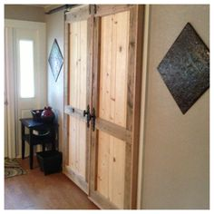 Custom Sliding Barn Doors. We uses Recycled Pallet Wood and custom made barn hardware. Call us for you custom furniture. The Rustic Acre ~ College Station, TX