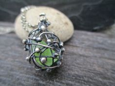 peridot cage necklace, rough gemstone pendant, august birthstone, cage of thorns by SeverinMetals on Etsy https://www.etsy.com/listing/200804322/peridot-cage-necklace-rough-gemstone