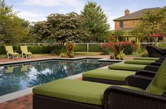 Lounging by the pool - Patio Ideas to Make Your Backyard the Ideal Summer Escape